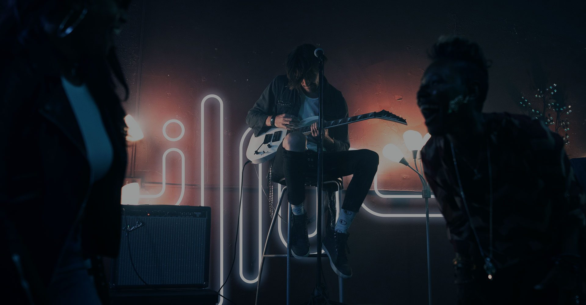 Music production equipment in blue and neon tones